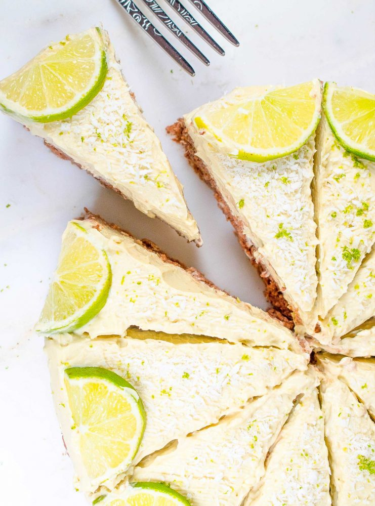 Cashew nut key lime cheesecake with mango and sprinkled desiccated coconut and lime zest