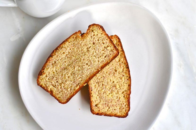 Banana bread loaf on white plate