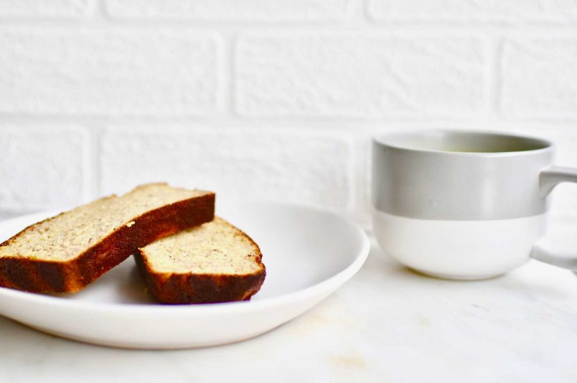 Brunch Banana bread loaf on white plate with matcha latte