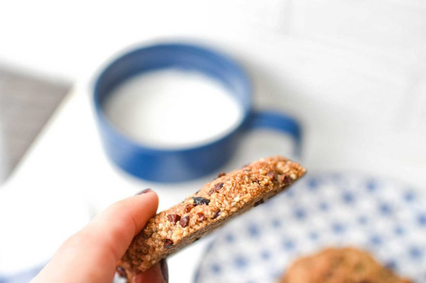 Cinnamon Cranberry Cacao Cookies on blue plate with almond milk