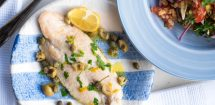 Sea Bass with a mustard dressing, capers and olives.