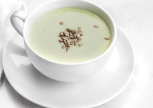 Cream of Celery Soup with Pumpkin Seeds in Soup Cup Thumbnail