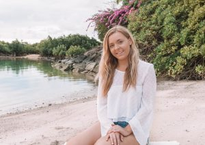 Girl on beach in Mauritius recovering health journey ME and chronic fatigue