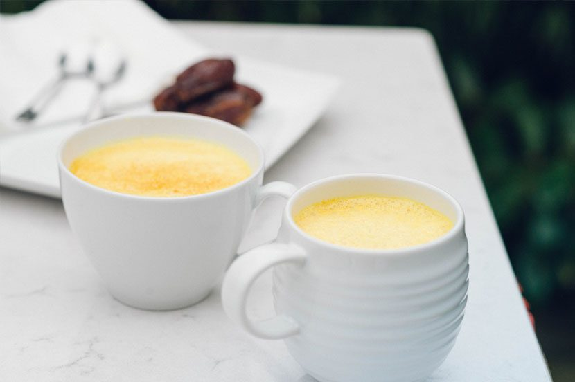 Two Turmeric Lattes with dates