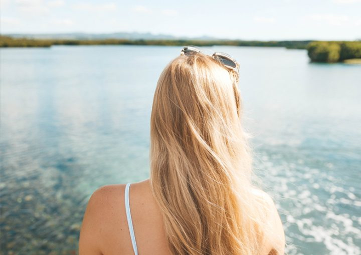Breaking Comparisons Blonde looking out at sea in Mauritius