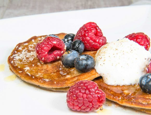 buckwheat and banana gluten free and dairy free pancakes with berries and coconut yoghurt