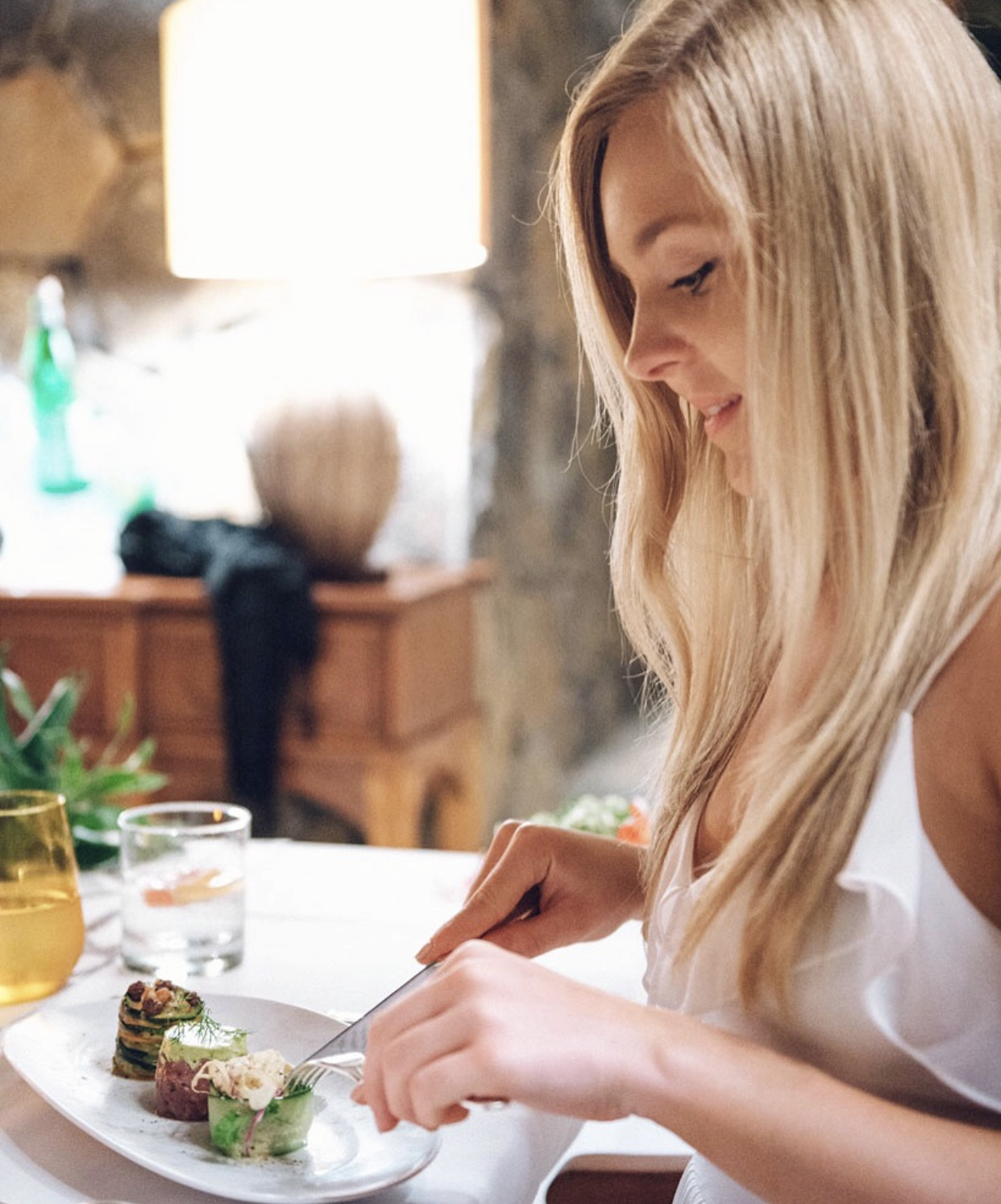 Blonde girl eating healthy food